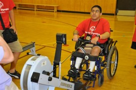 The indoor rowing machine is easily adapted for all kinds of  users.  Here a Special Olympian in a wheelchair tries it out.