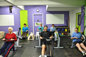 Indoor rowing class at The Body Shop
