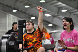 Special Olympics athlete celebrates a great row