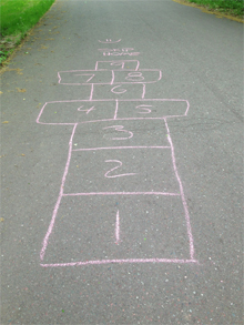 Warm up your workout with hopscotch and skipping