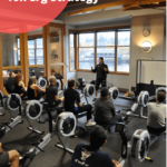 A master instructor teaching indoor rowing basics to rowing certification event