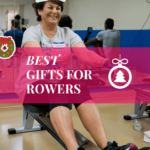 A woman riding a concept2 rowing machine, smiling because it's Christmas.