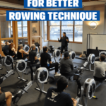 Group of people listening to a master instructor on how to improve indoor rowing technique